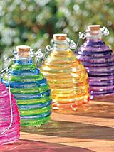 Large Wasp Trap - Glass Wasp Jar - Wasp Killer | Solutions / Large Wasp Trap is an instant color spot, too. With its thick, ribbed glass and bright hue, this trap is like glass art that also protects you from stinging wasps. No toxic chemicals. Simple sugar water or soda lures wasps through an opening on the bottom, trapping them in a sugary moat. Cork plug prevents them from flying out, but makes the jar easy to clean.