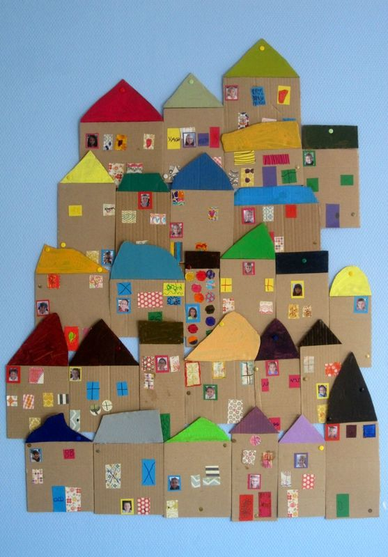 Love these cardboard and collage houses, a great group art project