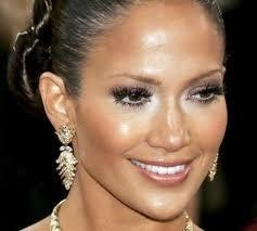 Boycott Jennifer Lopez. She wears fur of innocent, slaughtered animals and to go a step further, those eyelashes she's wearing are made from mink.