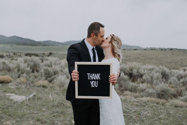 veil photo, bridal hair, bridal photos, grey suite, lacey wedding dress, green b…