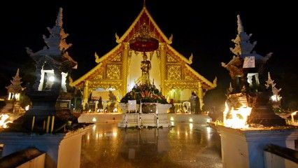 Magha Puja day in Wat Phra Singh. Chiang Mai, Thailand. Empty shrine full of candles.