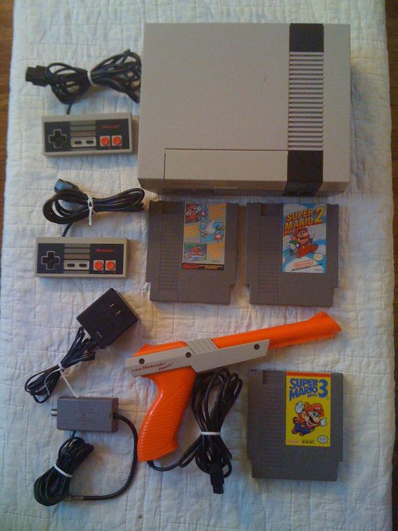 Original Nintendo with Super Mario games, duck hunt and 2 controllers.