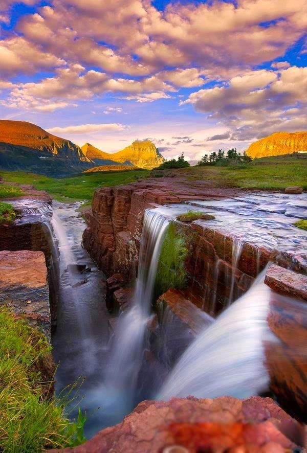 Triple Falls Glacier National Park - located in the U.S. state of Montana, on the Canada–United States border with the Canadian provinces of Alberta and British Columbia.