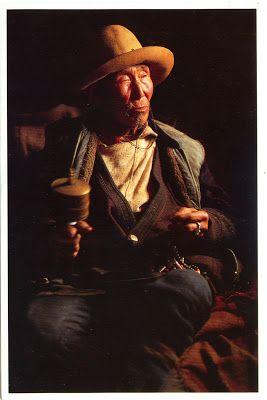 CHINA (Tibet) - An old Tibetan man with a Mani wheel