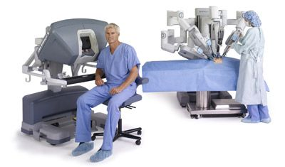 da Vinci System Si Surgeon Seated at Console and Nurse at Cart