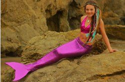 fake mermaid tail that you can actually swim in!!!    so getting one at the2tails.com!