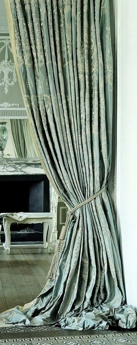 Mint crush drapes / curtains, floor to ceiling, creating illusion of extra height in the room.