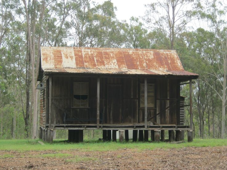 Early Australian bush hut, vertical timber boards with external bracing.