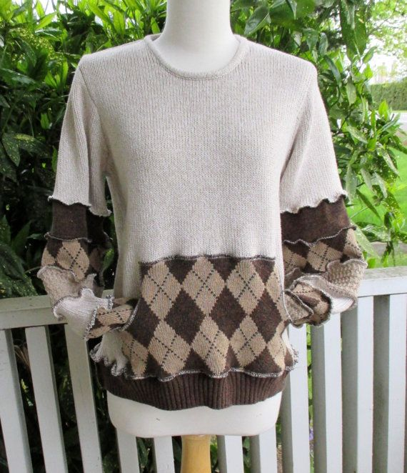 Unisex recycled sweater in beige with brown and caramel argyle lined kangaroo pocket. Patchwork stripes pockets and thumb holes. Sweater body was Banana Republic, great quality knits throughout. Professionally serged and finished seams.  Bust measures 38 - 42 Back neck to hem is 23 Underarm to cuff measures 20  All of the sweaters used to create this garment are 100% cotton.  Hand wash lie flat to dry. Store folded, never on a hanger.