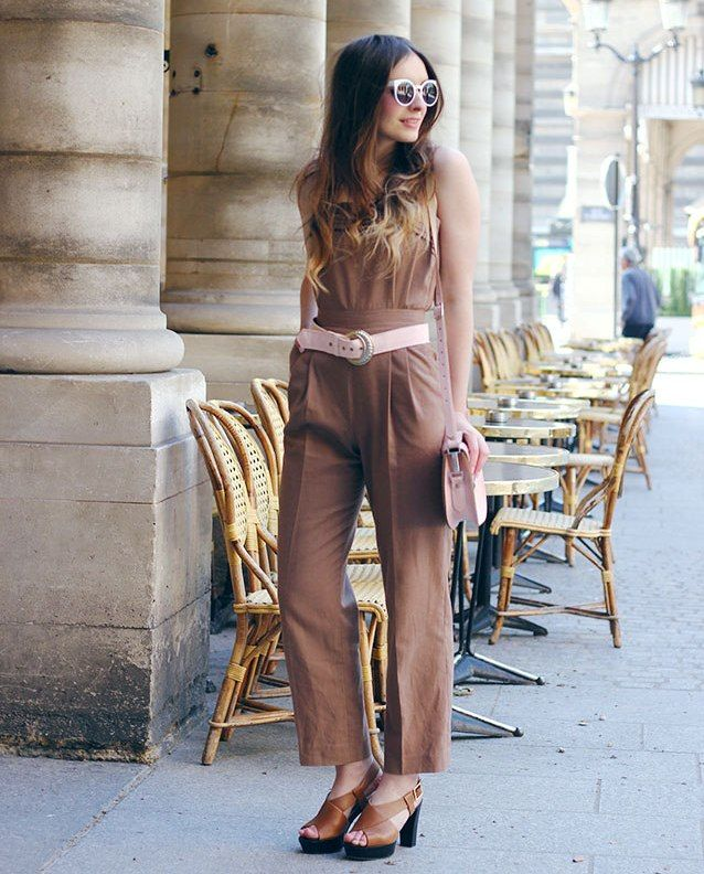 camel jumpsuit with belt and sunglasses