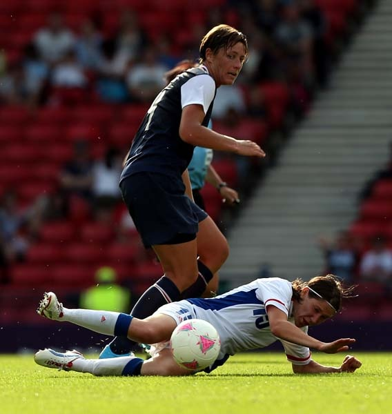: Becky Sauerbrunn of USA challenges Elise Bussaglia of France during the Women's soccer first round Group G Match of the London 2012 Olympic Games between United States and France, at Hampden Park on July 25, 2012 in Glasgow, Scotland.