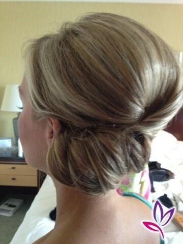 Low upside down twist bun with volume at crown and side swoop.  CREDIT: Jewel Hair Design: Kirsten Eike www.jewelhd.com