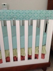 How to make rail covers with snaps. I'm gonna have to try this since my first child chewed up the wood on his crib and I'd like to use it for the next baby. Perfect cover up and cute!