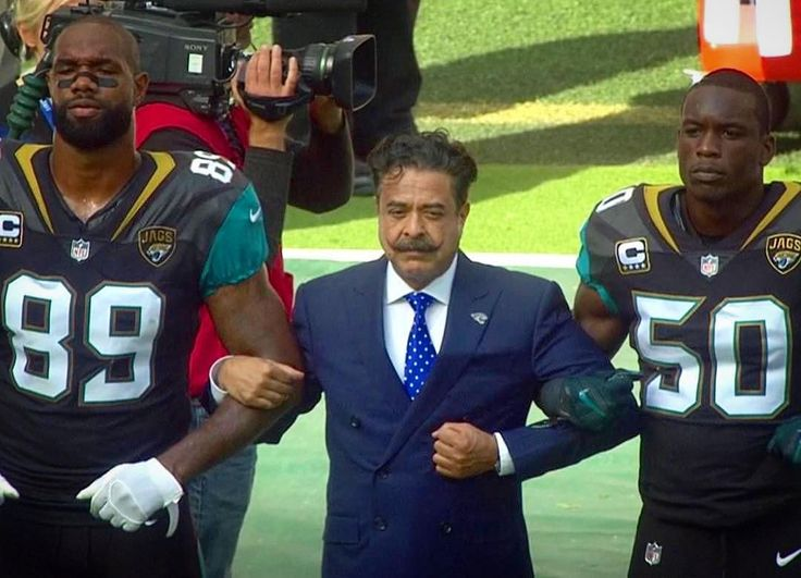 "@jaguars Owner Shahid Khan (A Billionaire), STOOD ARM & ARM in #Solidarity with HIS TEAM Today in #London. @realdonaldtrump ...... Are you going to call Mr Khan an #SOB?? The Only SOB I see right now is ""The BIG FAT ELEPHANT in the Room"" (YOU)!!! #NFL #Jags #Solidarity #TakeAKnee #1stAmendment #CivilRights #HumanRights #PeacefulDemonstration #Ravens"