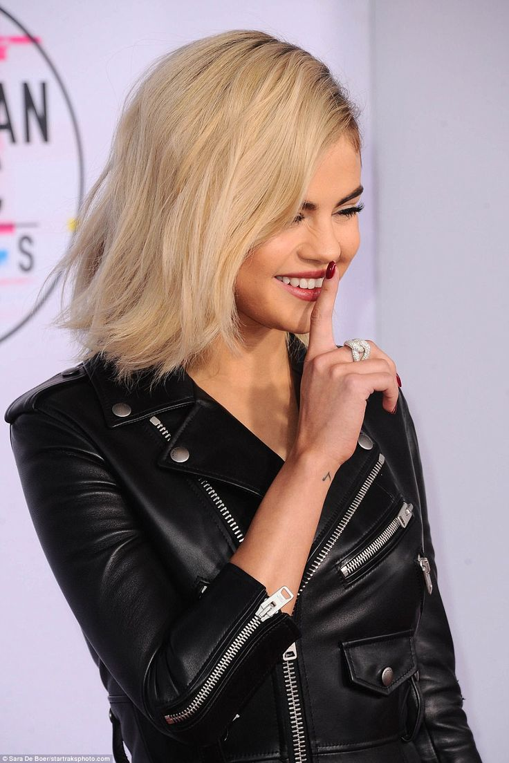 Giddy:Selena, a natural brunette, showed off her surprising new hair color as she walked the red carpet