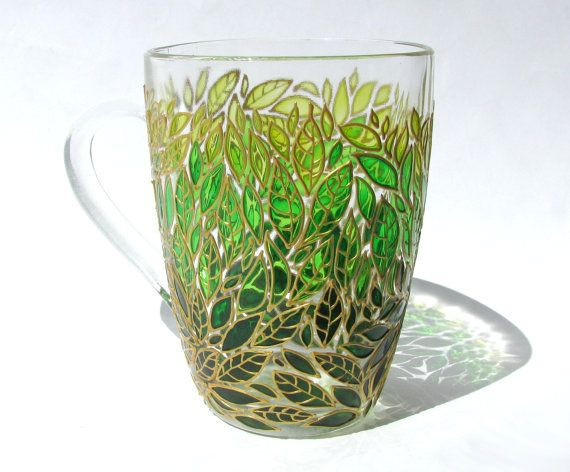 Green Leaves Mug Glass Hand Painted Mug Painted Coffee Mug Custom Painted Coffee Mug Leaves Design Mug  This is a bright glass coffee mug with hand painted cute green, emerald green and light green leaves. It can make a unique gift for any occasion or to be a great decoration in your house and make drinking coffee or tea more enjoyable :). It can also be a part of beautiful set with other glass pieces with the same design. A great gift for your coffee lover!  To customize your mug, please…