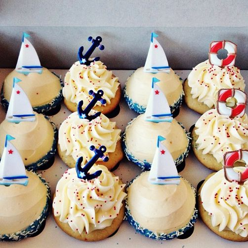 simple white cupcakes topped with inexpensive store bought nautical cupcake toppers