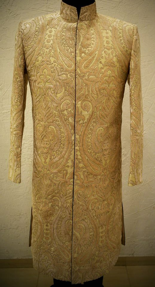 Beige sherwani with antique highlights wrapped in moon and white yarn