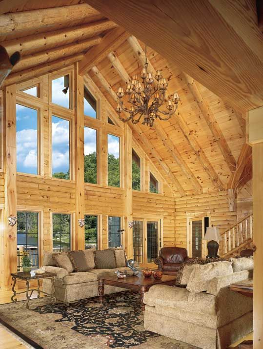 living room love the windows high ceiling and log cabin feel