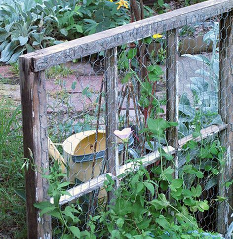 stapledchicken wire onto an old wooden window frame. Such a clever way to recycle in the garden! And cute, too.