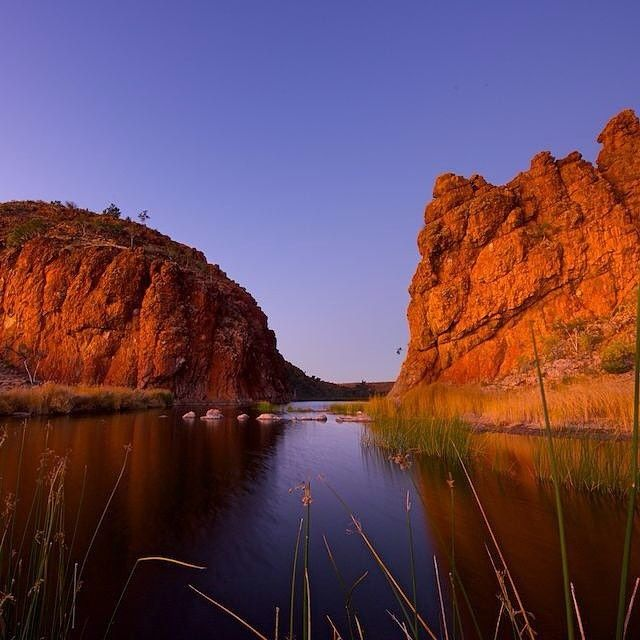 Here's some solid proof for you that sunrise at Glen Helen Gorge is definitely worth getting up early for! Located 132 kilometres from #AliceSprings in @ausoutbacknt, the landscape around here is truly spectacular and includes views of the West MacDonnell Ranges and Mount Sonder - one of the highest points in Central Australia. Photo: @granthuntphoto