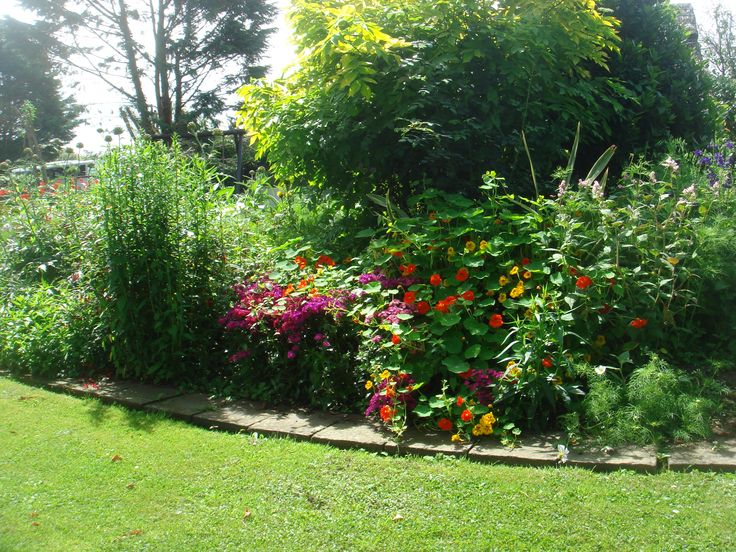 Organic flower gardens with picnic areas, communal barbecue, children's play house.