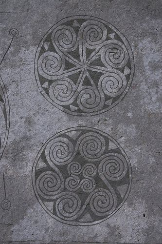 Viking picture stones.....paint design on round pavers for walkway.....by fresh aspect-found on flickr.com