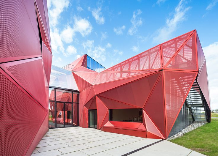 Triangular Facets Of Perforated Red Metal Frame The Entrance To This  Cultural Centre