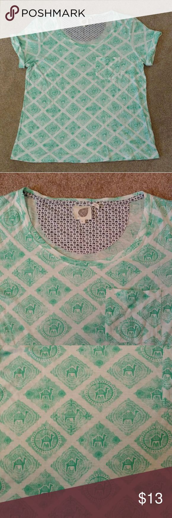 Anthropologie Camel Tee This cotton modal tee has a lightweight, easy fit that's perfect for a sunny day. A front pocket and roll cuff sleeve add cute detailing to this casual tee. Originally purchased from Anthropologie, tag reads Luka. Excellent condition - No snags, holes or stains. Anthropologie Tops Tees - Short Sleeve