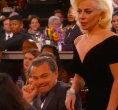 …as Gaga walked by.   Leonardo DiCaprio's Face When Lady Gaga Walked By Him To Accept Her Award Is Everything