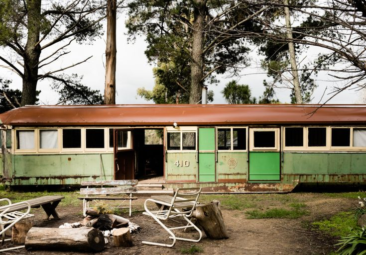 Decide who's sleeping in the kitted-out tram, 1950s caravan or the cottage; then go fix cocktails in the tiki bar.