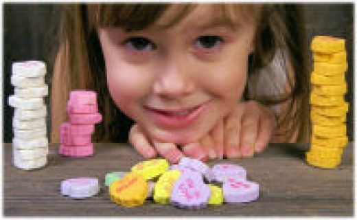 Stacking heart challenge game:    Stacking heart challenge game requires a plenty of conversation hearts. The key of the game is to build the tallest tower in 30 seconds. When the time ends up, kids counts the hearts to see who is the winner. This game creates plenty of fun for kids.