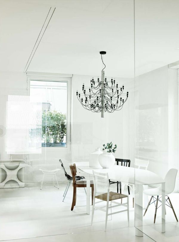 All white walls combined with delicate furniture and gino sarfattis 2097 pendant lamp introduces elegant structure
