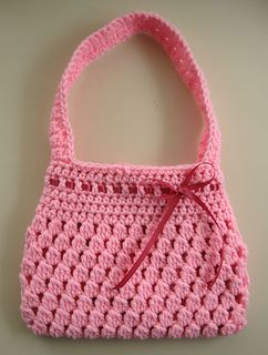 This is a quick little bag, perfect for a small child. The color reminds me of Bubble-licious Gum, and it is mainly comprised of bobble stitches, hence the name. You will make the main bag-body in the round, then attach the straps. The bag body measures about eight inches by six and a half inches at its widest points. The strap length will be up to you.