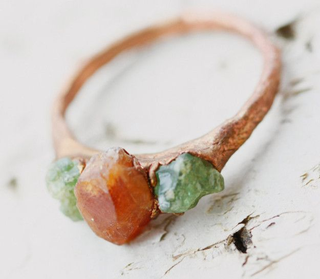 And a copper ring fashioned with colorful garnets that is both budget-friendly and unique.   31 Stunning Engagement Rings That Aren't Made With Diamonds