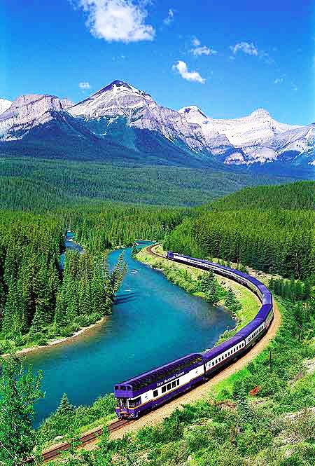 Train Travel along with Bow River at Morants Curve, Alberta,Canada: