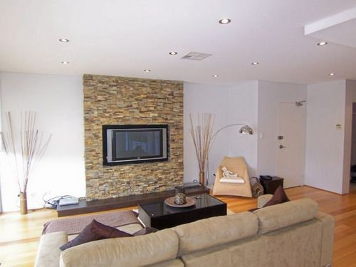 adding a stone accent wall adds so much sophistication to ...