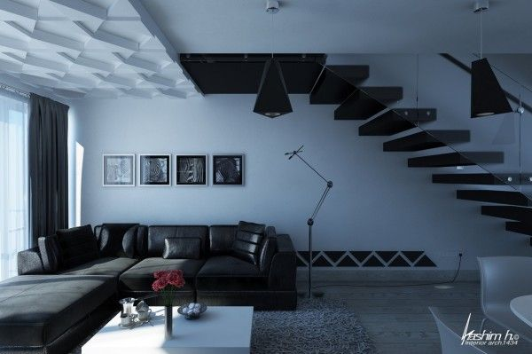 """Nestled beneath the second floor landing, the leather sofa and art photography in this living room scream """"bachelor pad."""""""