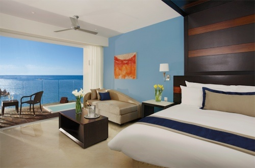 A soothing guest suite at Secrets Huatulco resort in Mexico
