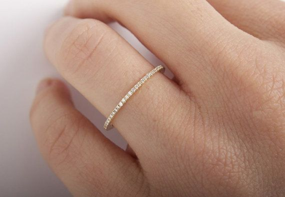♥This super sweet and super thin ring is just enough sparkle for interest! ♥All stones used are only premium cut, fairly traded, and/or conflict-free! Our diamonds are always natural NEVER treated or enhanced for better color or clarity, unless per client request. Our products are only created with the finest of recycled metals.  ♥JewelryULovebyAby works hard to save the world one piece of jewelry at a time! :)  ♥Diamonds go thru entire ring (Full way eternity) ♥Diamond quality: F in color…
