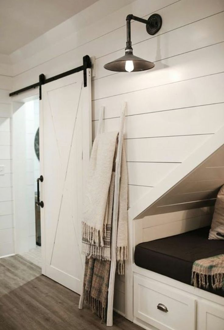 Basement under stairs nook farmhouse industrial lighting barn doors shiplap white neutrals via Linen and Flax Home (FB, instagram and blog)