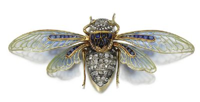 Brooch made by Boucheron in the 1890's depicting a cicada with the most exquisitely made wings in plique-à-jour enamel and calibre cut sapphires. The head and the body are set in diamonds and sapphires as well and the eyes are set with two cabochon cat's eye crysoberyl.