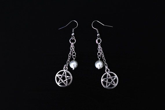 Handmade, one of a kind pentagram earrings with chains and white beads.  The…