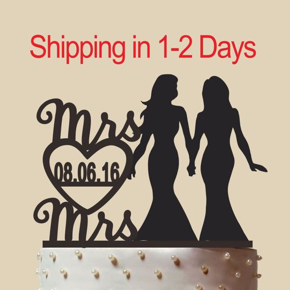 mrs and mrs wedding cake with heart decor Lesbian wedding