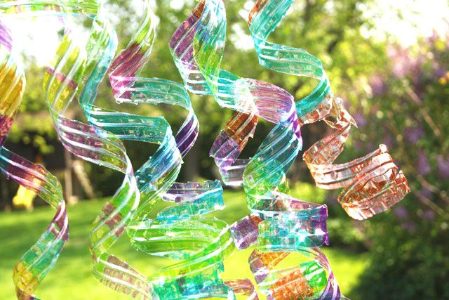 http://www.2uidea.com/category/Water-Bottle/ Recycle used water bottles into colourful wind spirals.