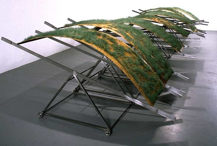 "Canan Tolon. Under Pressure, 1994, grass on sheemetal in tension and steel support, 40"" x 92"" x 200""  (100 x 243 x 508 cm). Each fragment: 40"" x 92 x 24"" (100 x 243 x 61 cm)"