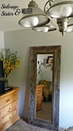 Goodwill mirror turned into a pottery barn hack with some salvaged wood and some time, for under $50. www.salvagesisterandmister.com