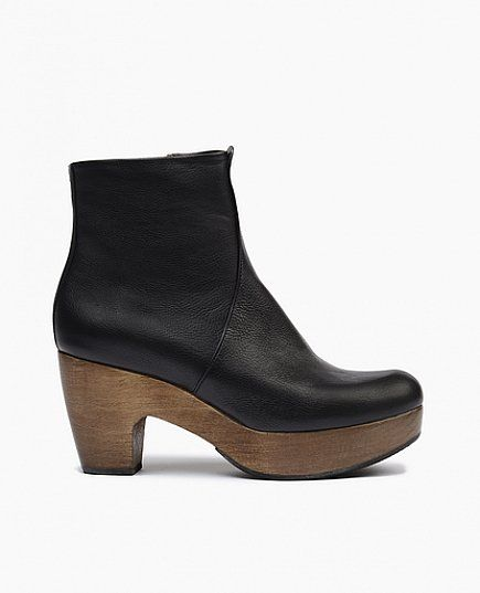 Clean lines, snug fit and curved solid wood platform heel make this clog boot a timeless classic. Inside zipper closure.Italian veg tanned leather upper with solid wood base Heel height : 3 inches wit