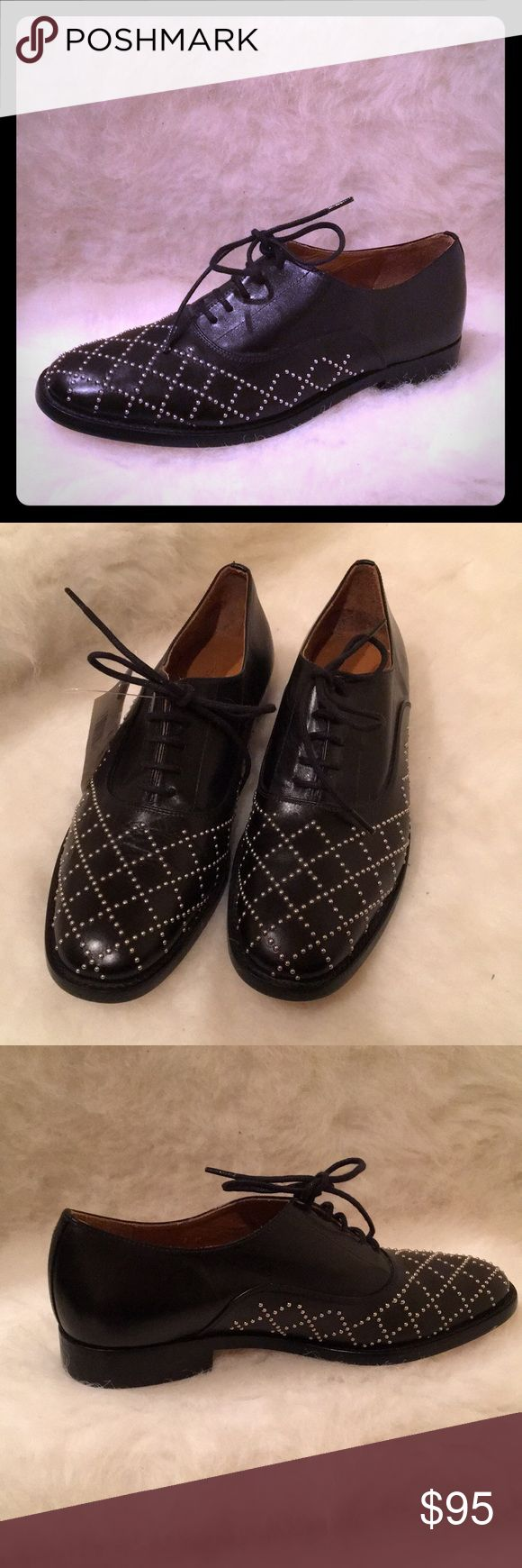 "NWT Delman Black Leather Lace-up Studded Oxford NWT Luxurious leather upper with leather lining and leather sole. Nickel tone small studs. Made in Spain. Approx 3/4"" heel height. While these are unworn, NWT salon shoes, see the last photo for a very minor uneven area on bottom of heel of left shoes. A gorgeous, comfortable oxford. Delman Shoes Flats & Loafers"