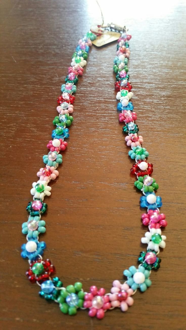 Daisy Chain necklace in pink, aqua, green and red with magnetic clasp.